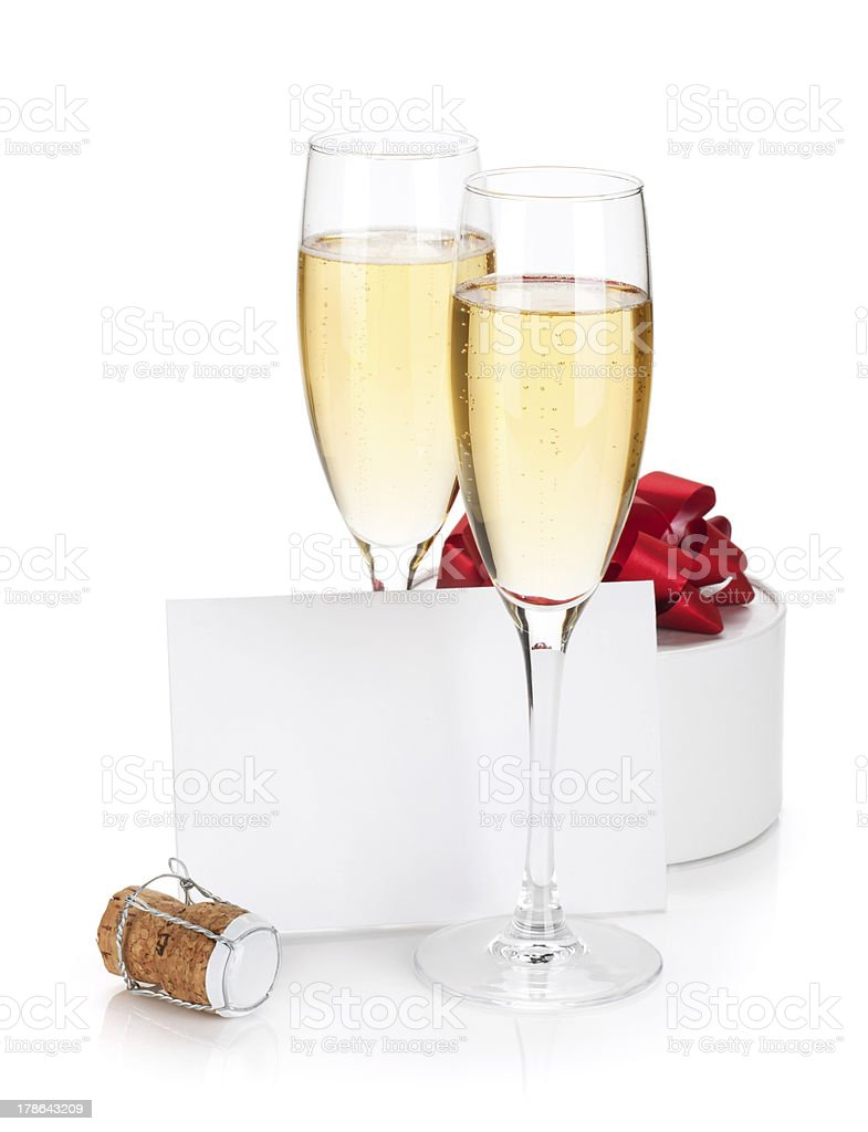 Champagne glasses, empty card and gift royalty-free stock photo