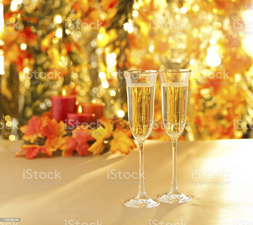 Champagne glasses for reception in front of autumn background royalty-free stock photo
