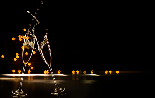 Champagne Glasses Infront Of Defocused Lights