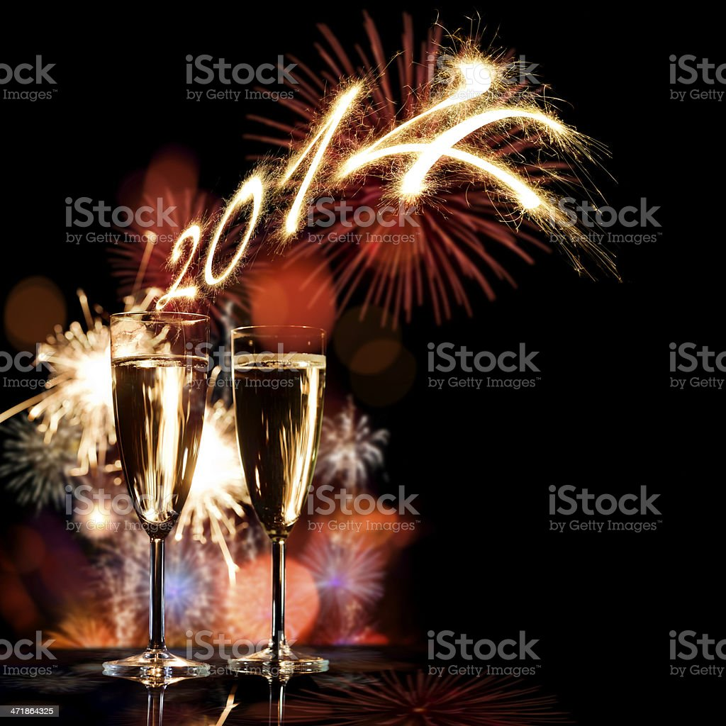 Champagne Glasses Infront Of Fireworks – New Year 2014 royalty-free stock photo