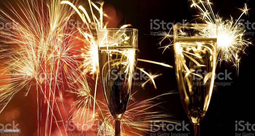 Champagne Glasses Infront Of Fireworks – New Year 2016 royalty-free stock photo
