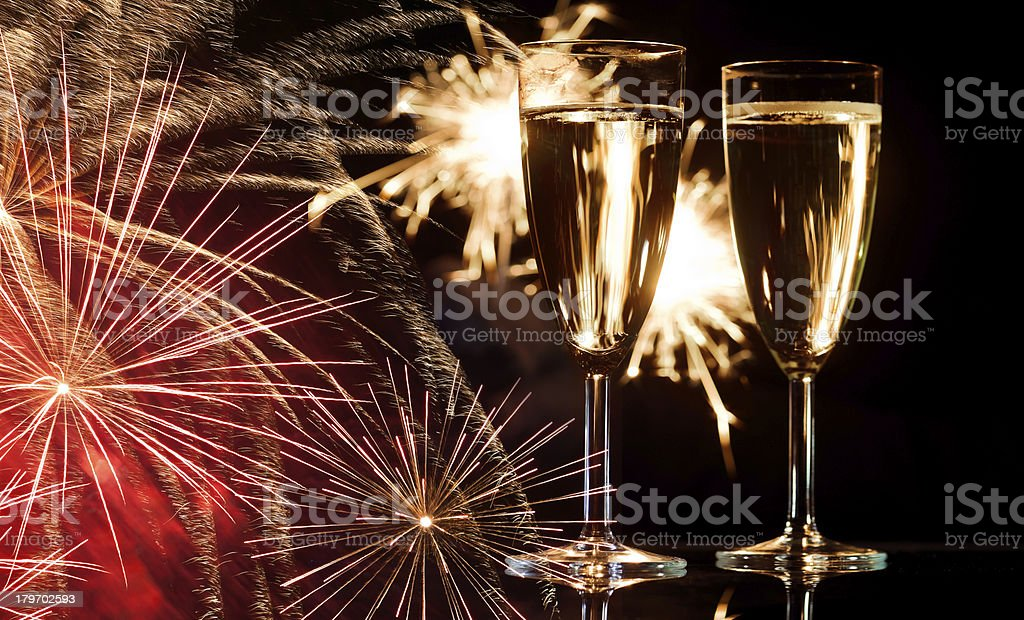 Champagne Glasses Infront Of Fireworks royalty-free stock photo