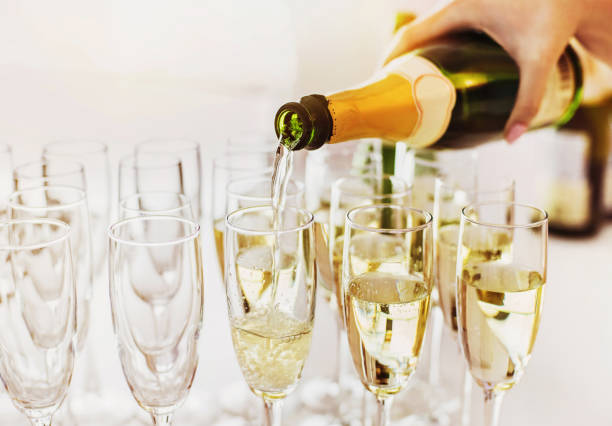 champagne glasses on a party - champagne stock pictures, royalty-free photos & images