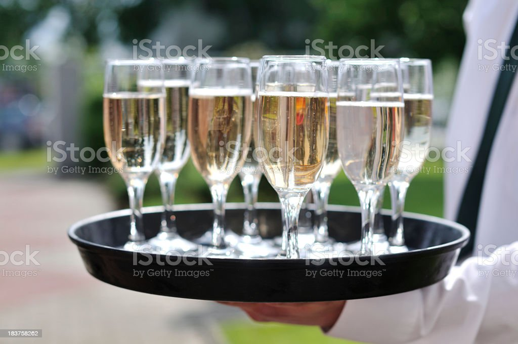 Champagne glasses on a tray royalty-free stock photo
