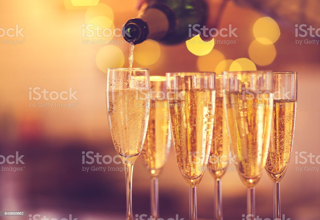 Champagne glasses on gold background. Party concept stock photo