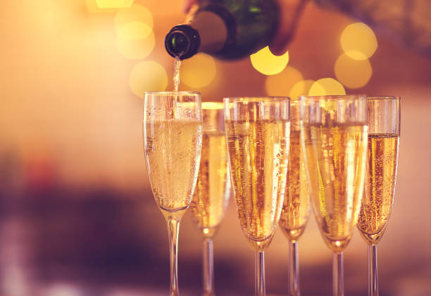 champagne glasses on gold background. party concept - champagne stock pictures, royalty-free photos & images