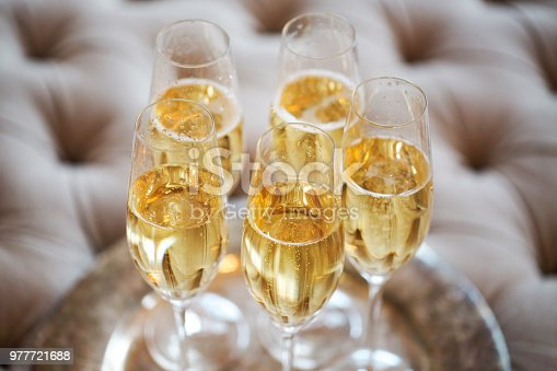 istock Champagne glasses on silver tray 977721688