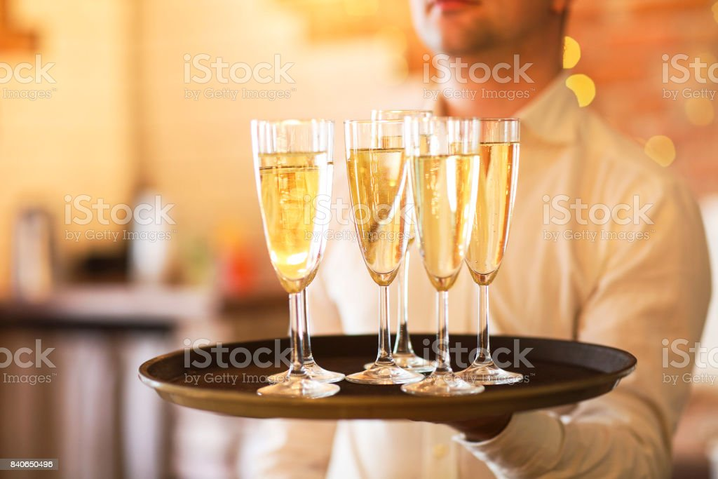 Champagne glasses on tray. Party and event concept stock photo