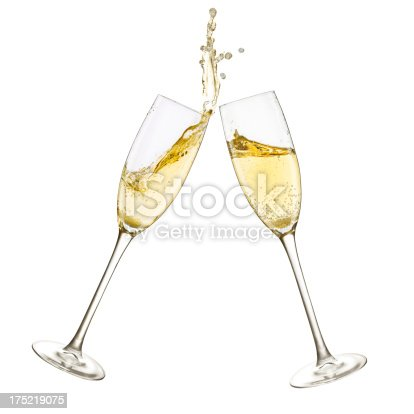 Close up shot of a toast and splash with two champagne glasses. Isolated on white.