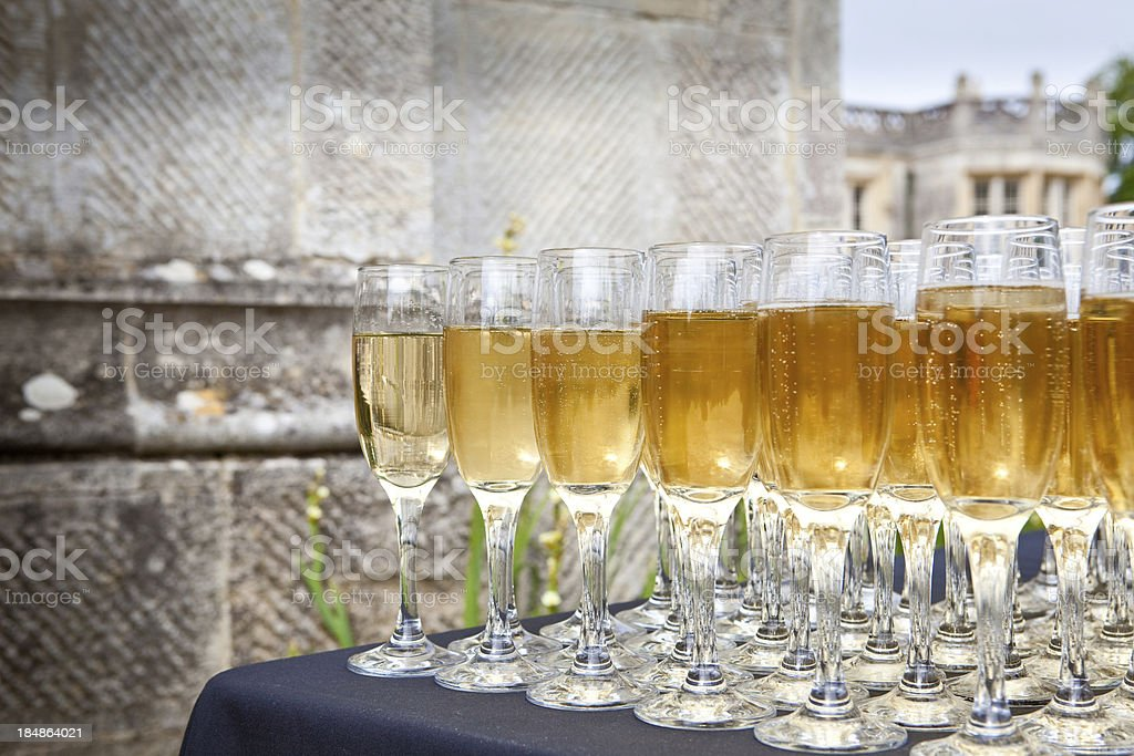 champagne glasses with castle in background stock photo