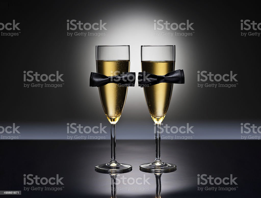 Champagne glasses with conceptual same sex decoration stock photo