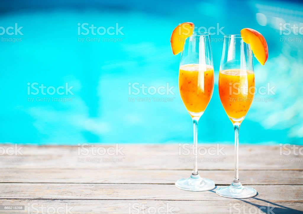 Champagne glasses with peach Bellini cocktail stock photo