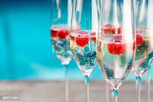 istock Champagne glasses with raspberry 665212634
