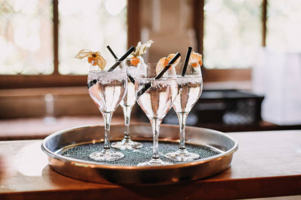 champagne glasses with sparkling spritzer at summer wedding party stock photo