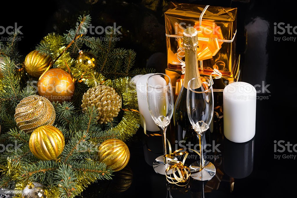 High Angle View of Festive Still Life - Bottle of Champagne with...