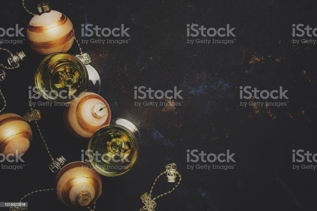 Champagne In A Glass, New Year or Christmas Decorations, Black Background, Top View and toned image stock photo