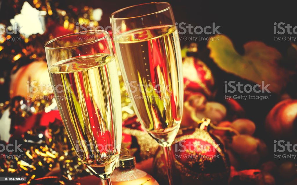 Champagne In A Glass, New Year or Christmas Decorations, Vintage Wooden Background, Selective Focus and toned image stock photo