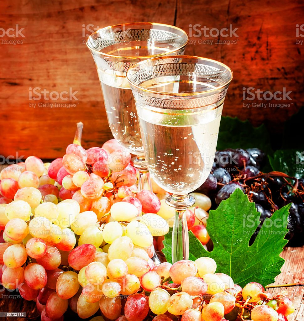 Champagne in glasses and fresh grapes stock photo
