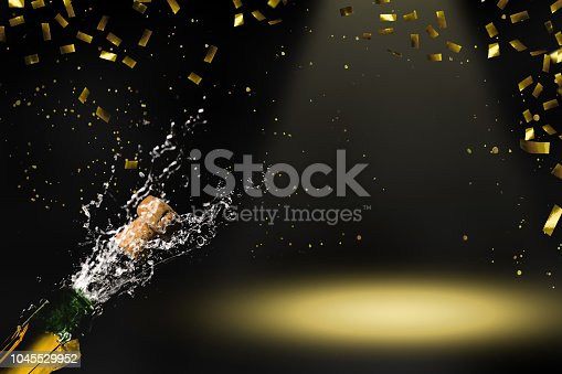 1051699126 istock photo champagne in raining gold confetti 1045529952