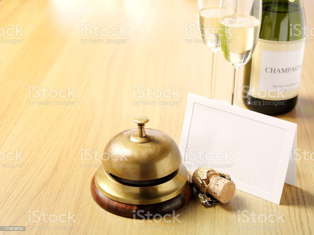 Champagne Invitation by the Concierge Bell royalty-free stock photo