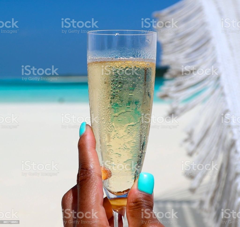 Champagne on the beach stock photo