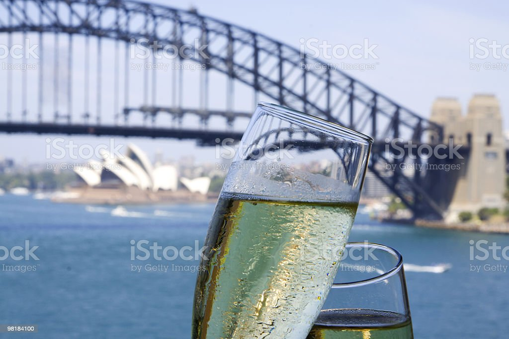 Champagne overlooking sydney harbour bridge royalty-free stock photo