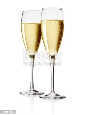 Two Flutes of Champagne isolated over white background.