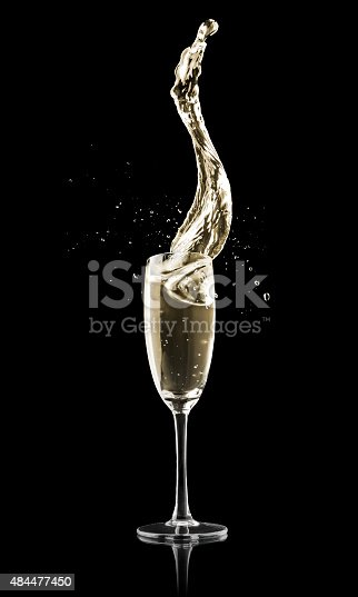 An elegant glass of Champagne on a black background.