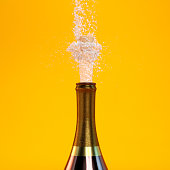 Champagne splash on orange background