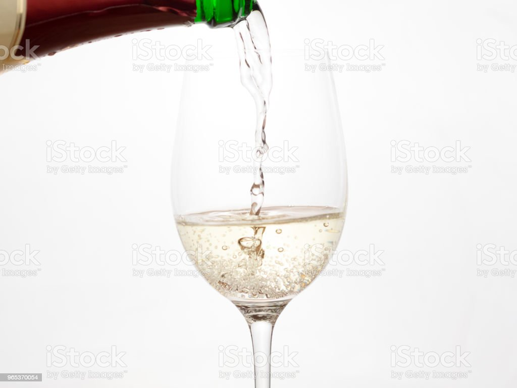 Champagne pouring into a glass zbiór zdjęć royalty-free