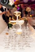 Vertical color image of champagne pyramid, wedding reception and celebration.