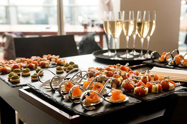 champagne reception - ordövr stok fotoğraflar ve resimler