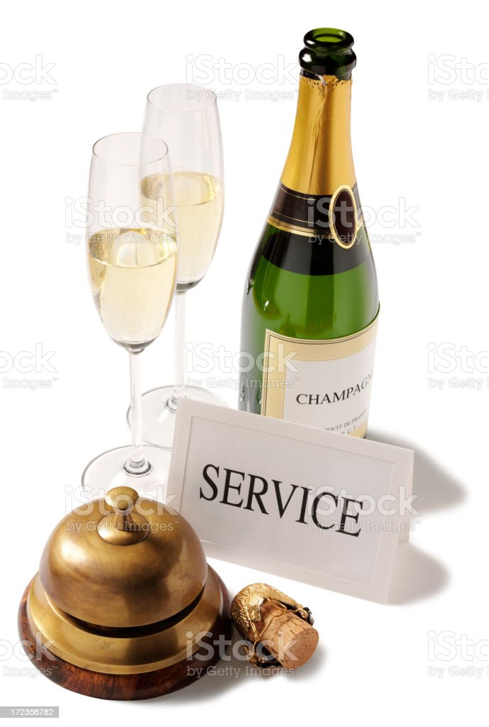Champagne Service with a Concierge bell and Glasses royalty-free stock photo