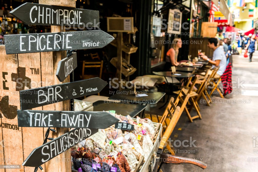 Champagne shop and people in cafes stock photo