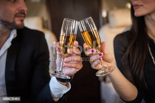 istock Champagne toast in private aeroplane 496628464