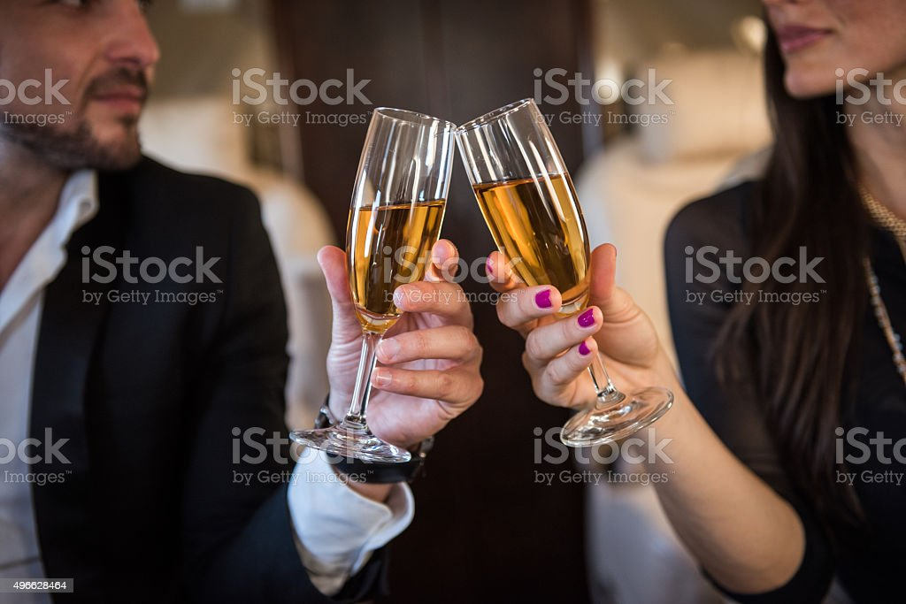 Champagne toast in private aeroplane stock photo