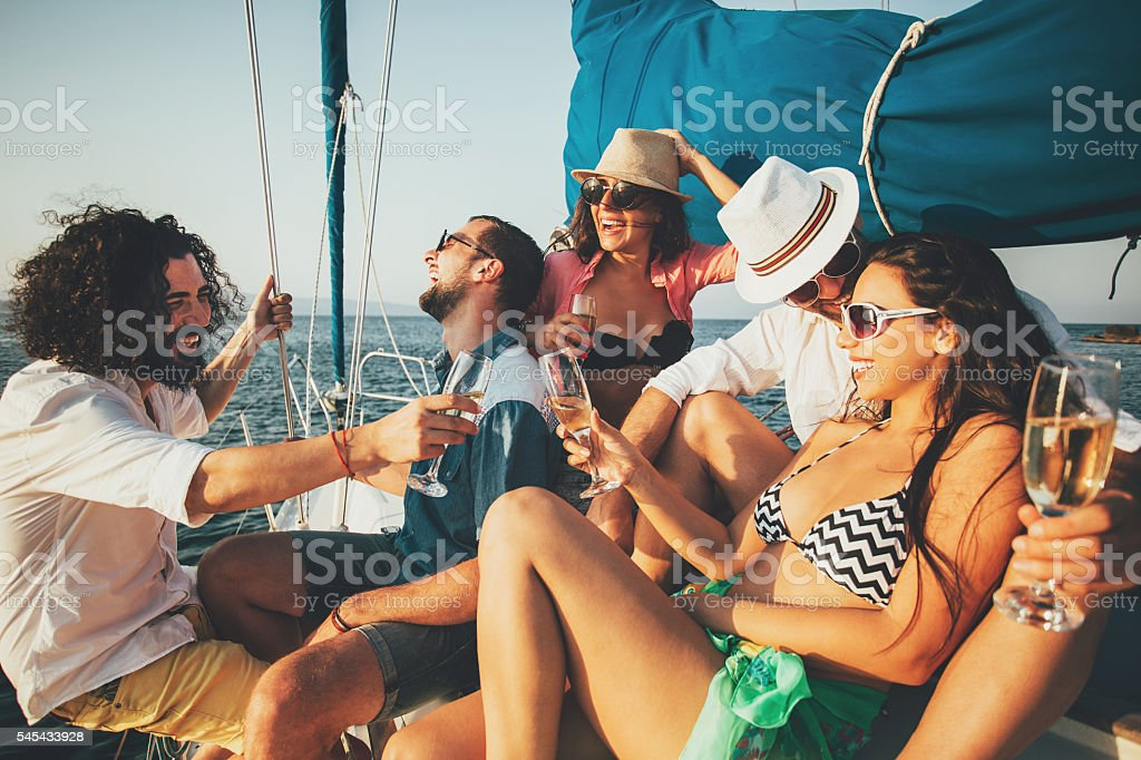 Champagne toast on a yacht stock photo