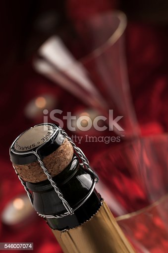 1073474208istockphoto Champagne wine bottle cap with glass 546007074