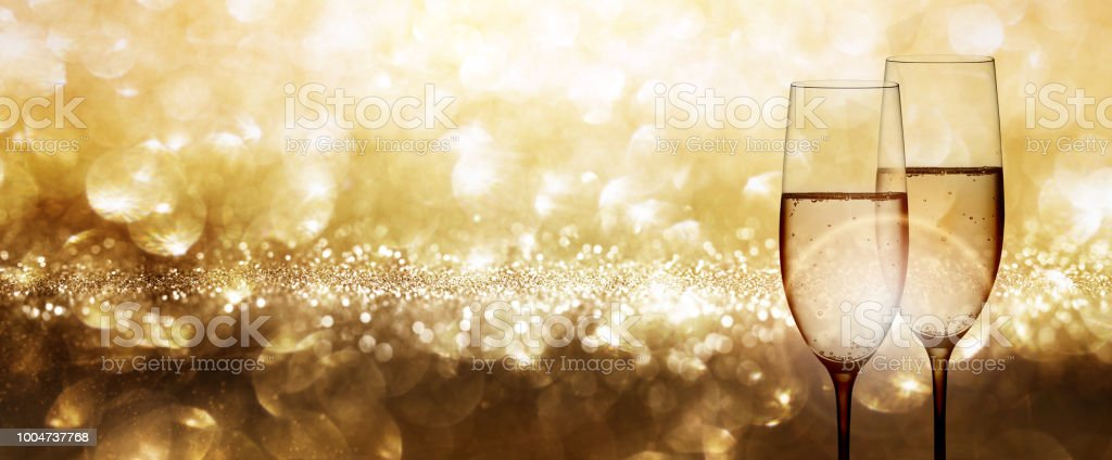 Champagne with festive gold background and shiny bokeh effects for a...