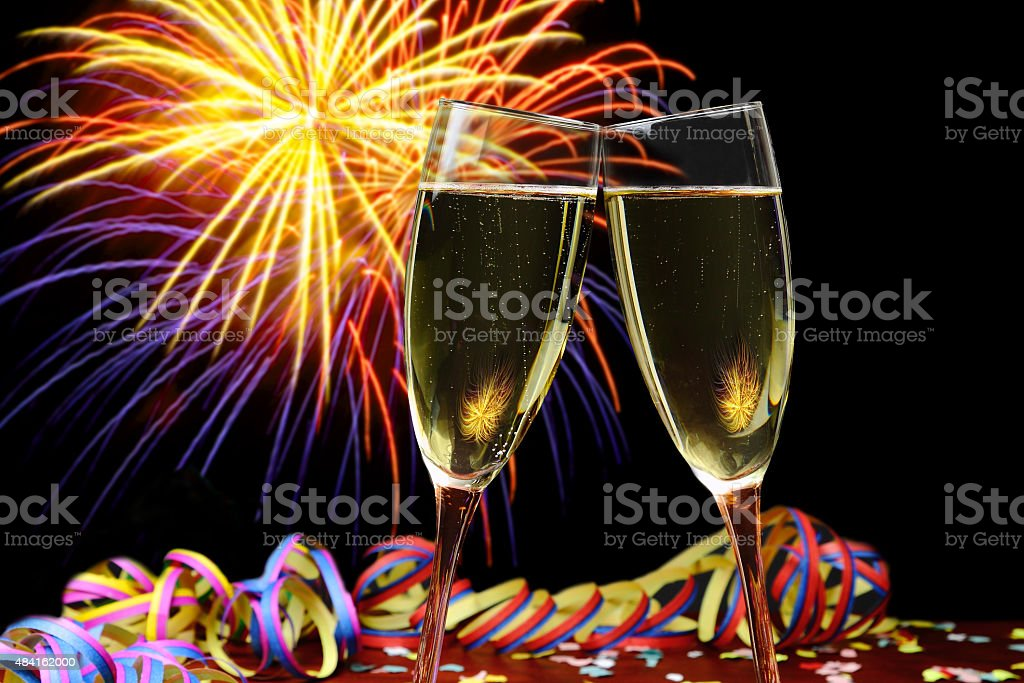 Champagne with fireworks in the background stock photo
