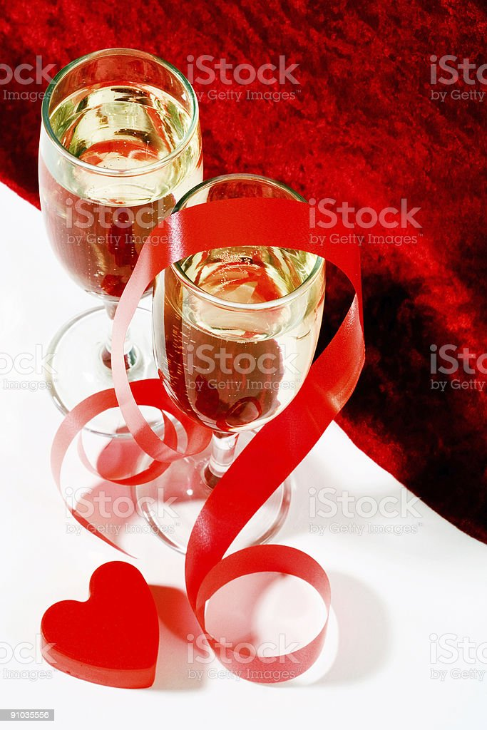 champagne with red ribbon and heart royalty-free stock photo