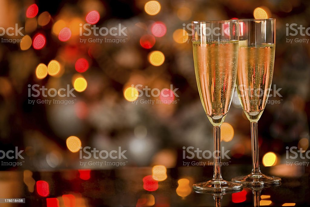Champagner on Glass Table with Bokeh background stock photo
