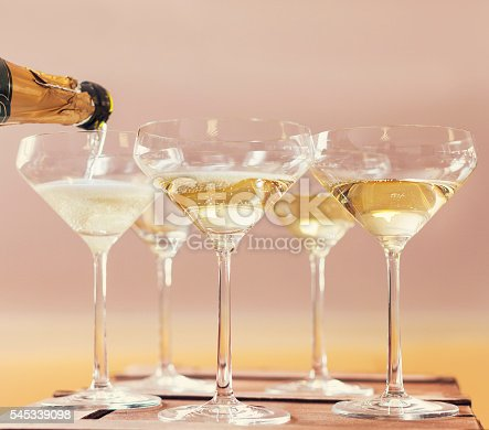 istock Champaign being pored into glasses 545339098