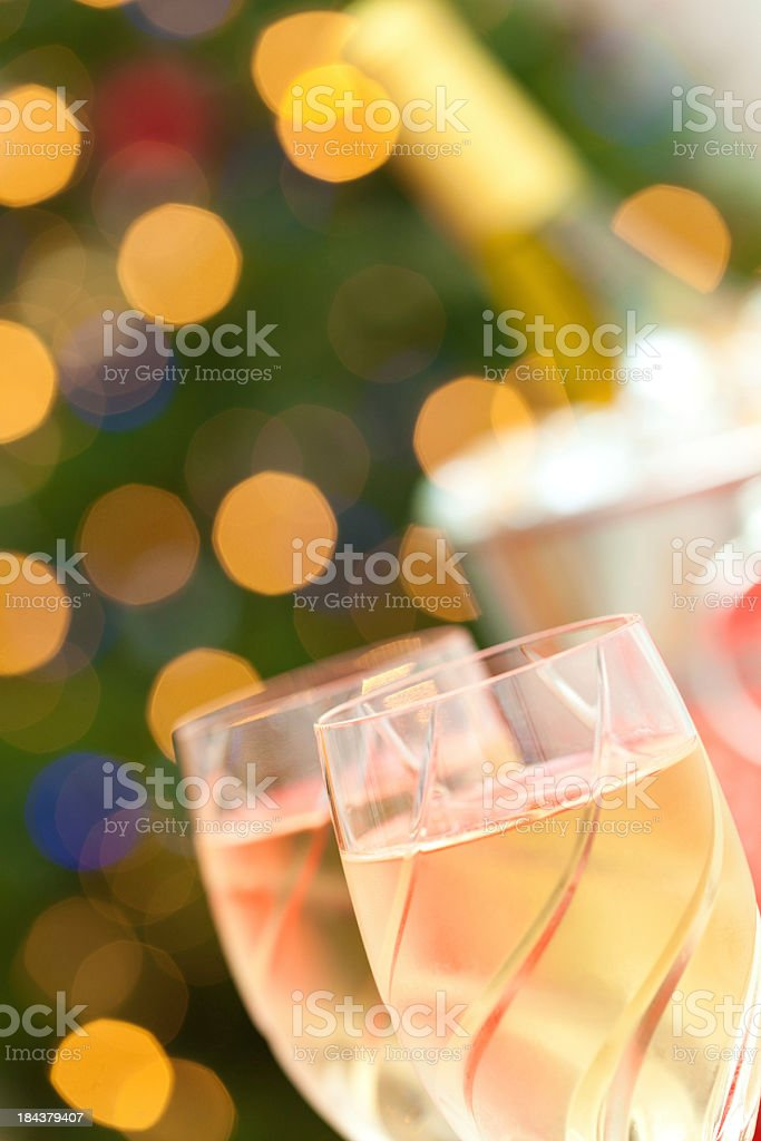 Champaign Glasses and Bottle in Front of Lit Christmas Tree royalty-free stock photo