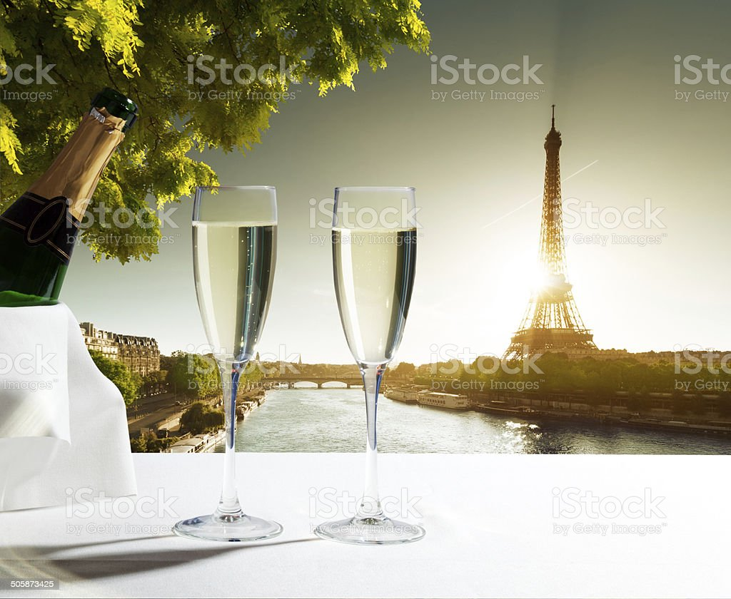champaign Glasses and  Eiffel tower in Paris stock photo