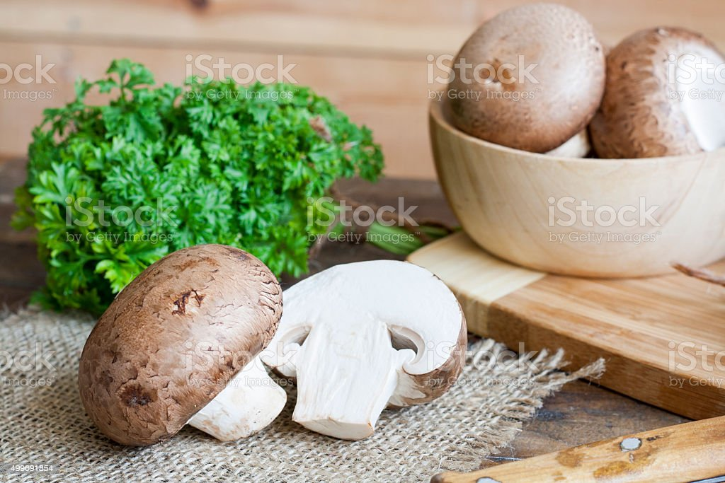 Champignon mushrooms, bagging and herbs royalty-free stock photo