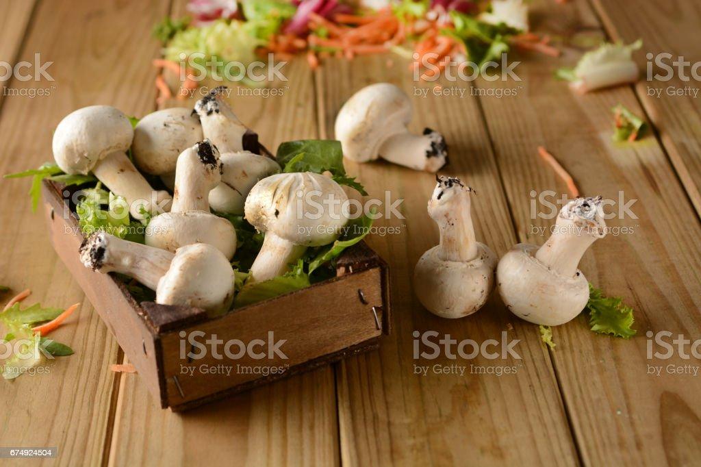 Champignon mushrooms on wooden table royalty-free stock photo