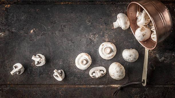 champignon on the copper pot on metal background top view - pilzpfanne stock-fotos und bilder