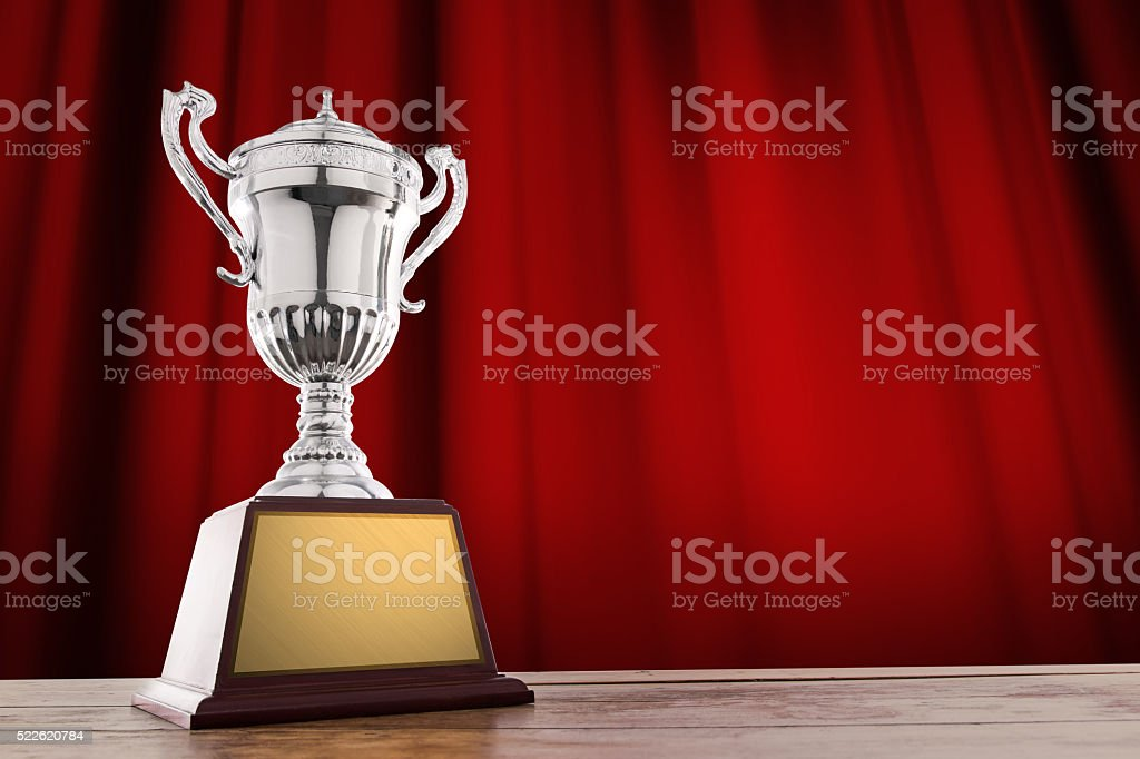 champion golden trophy on wood table stock photo