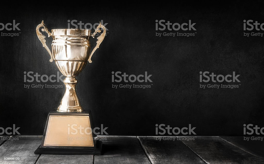 champion golden trophy on wood table with blackboard copy space stok fotoğrafı